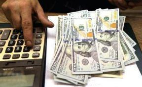 الدولار يتراجع الى ٤٠٥